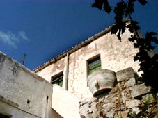 Crete property: traditional whitewashed house beneath cobalt skies