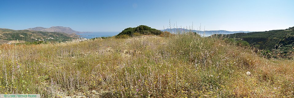 Large hilltop plot in building zone, sea & mountain views