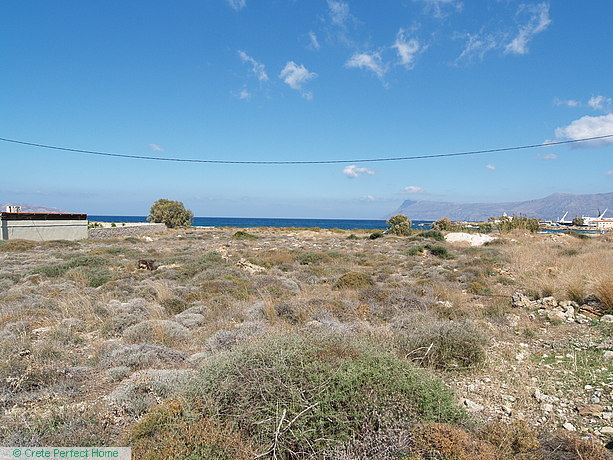 Large level plot with sea & mountain views