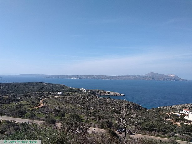 Large sloping plot in village limits, sea and mountain views, large build allowance