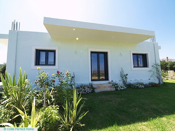 New 2-bedroom house with large gardens and sea/mountain views