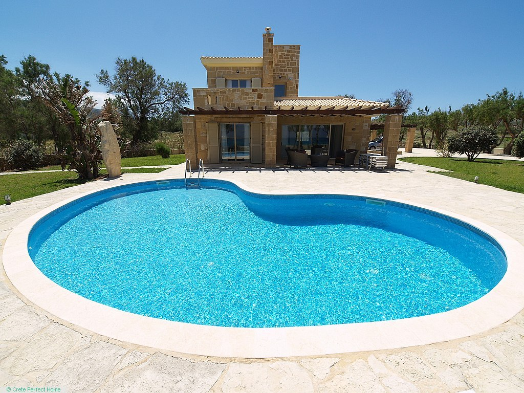 Gorgeous beachside stone villa in large plot with pool